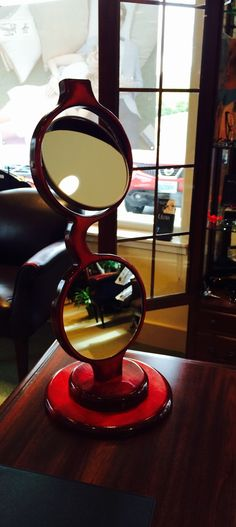 Our latest creation a table top mirror with a magnifying mirror that flips out of the way when you don't need it. Www.francesscholz.com