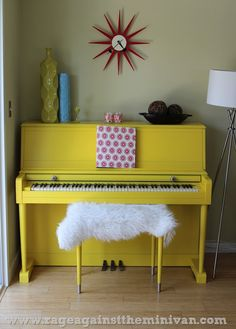 painted yellow piano Goldenrod from Dunn Edwards  $300 (regular house painter) Sanded then used auto-shop primer then spray-painted 3 coats of yellow! Faux sheep skin from Ikea.