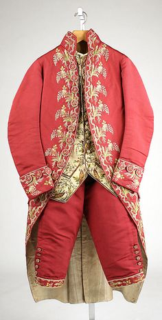 3-piece suit, Great Britain, 1775-1780. Red silk with polychrome floral embroidery; waistcoat: cream silk satin with floral embroidery.