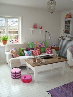Loving that white living room, with lots of pop!