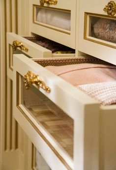 Because the homeowner loves detail, the designers covered every inch of her dressing suite with luxurious fabrics and finishes. As a result, accessories stored in this space enjoy the ultimate indulgence: drawers are lined with silk and trimmed with gimp braid. In fact, it's the same silk the designers used for the room's window treatments.