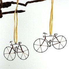 """This set of two handmade wire bicycles, each with a raffia loop, make unique holiday ornaments. Each bicycle is approx 4 inches in size. Called a """"boda boda"""" by the locals, bicycles are used as public transportation (you ride on a padded rack on t. Handmade Wire, Handmade Ornaments, Holiday Ornaments, Holiday Crafts, Christmas Decorations, Holiday Decor, Christmas Storage, Hanging Necklaces, Wire Art"""