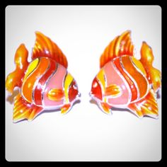 Vibrant Fish Stud Post Earrings Vibrant Fish Stud Post Earrings --- Metal Color is silver --- playful and fun fish in shades of orange yellow and pink ---dime size Vintage Jewelry Earrings