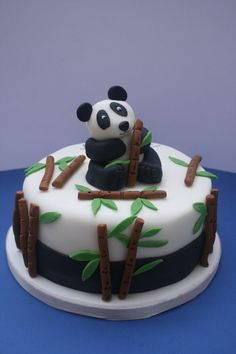 Panda cake - I made this cake for a mum who wanted a cake with a panda theme for her daughter. Have to say making a panda out of fondant is not easy. The bamboo shoots and leaves are handcut Panda Bear Cake, Bolo Panda, Panda Cakes, Panda Birthday Cake, Special Birthday Cakes, Birthday Cakes For Children, Tumblr Birthday Cake, Happy Birthday, Fondant Cakes