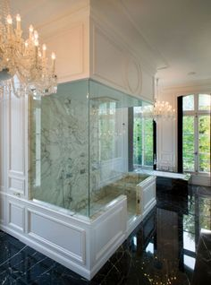 Lenny Kravitz Paris apt bathroom white carrera black marble chandeliers
