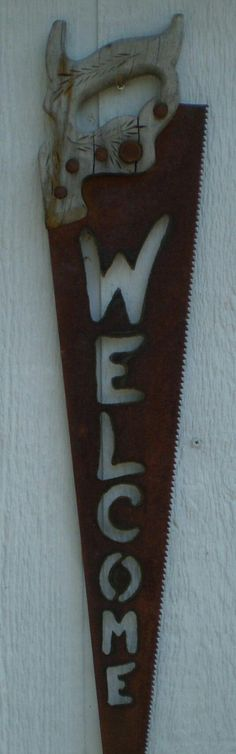 'Handsaw turned Welcome Sign'