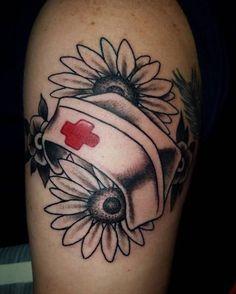 Nurse tattoo. Wild flowers and nurse hat.   Artist : Joshua Euton; bloodline tattoo ky