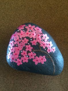 Cherry blossom painted rock