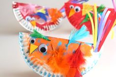 Paper plate birds ~ love the addition of feathers and paper strips