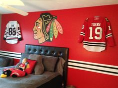 Chicago Blackhawks jerseys proudly displayed using the Ultra Mount Jersey Display.