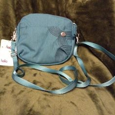 """SUMMER CLEARANCE SALE 🎈🎈🎈 A special process was used to make this bag. It was made from post consumer recycled bottles! This Eco Friendly bag has a front zip pocket, secure zipped closure, 1zip and 1 slip inner pockets, detachable and adjustable cross body strap. 7"""" high, 7.5"""" wide , 1.75"""" deep. Haikubags.com Bags Crossbody Bags"""