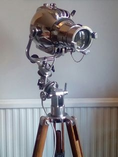 Refurbished English Strand 23 theatre stage light, on a , 1970's equatorial telescope tripod. Mike Bainbridge design.
