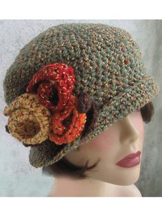Create this cute  Downton Abbey -style flapper hat with large flower trims.   This easy-to-stitch flapper-style hat is made using worsted-weight yarn and a U.S. size J/10/6mm hook. It is embellished with crocheted flowers and leaves, also included in the pattern. Made to fit most adult women.