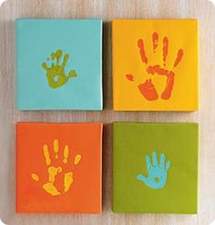 handprint on canvas, how cute.. I want to put this in the baby's room, only in frames and put our names on it. one for mommy,daddy, and  Bentley (the dog) and of course the little one. :)