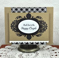 kraft with black is sophistication...  http://dawnmcvey.typepad.com/these_are_a_few_of_my_fav/2012/01/mat-stack-5-collection-celebrations-happily-ever-after-day-4.html