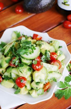 Fresh and simple Cucumber, Tomato, and Avocado Salad dressed with a light, flavorful citrus and honey vinaigrette.   www.thekitchenismyplayground.com