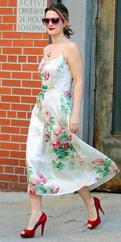 Floral dress, red pumps.
