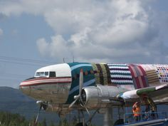 Jessica Vellenga writes about Yarn Bomb Yukon's project that covered a plane in #knitting and #crochet in Craftivism book