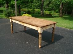 farm table similar to the one I would love to sand and bring inside to use as our dining table.