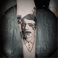 Poetic tattoo by Oked Oked blackwork surrealistic portrait