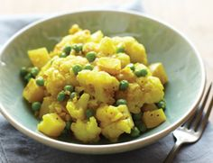 Curried potatoes with cauliflower and peas cooked in a pressure cooker