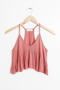"Details Size Shipping • 95% Rayon 5% Spandex • Soft baby rib tank top • Hand Wash • Line dry • Made in the U.S.A • Measured from small • Length 14"" • Chest 12"""
