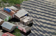 An aerial view of homes flooded by the overflowing Rio Negro - Manaus, AM