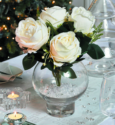 Seasonal floristry will always give a Christmas dining table an extra-special feel #christmas #dining #florisrtry