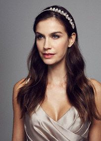 Perfect for any occasion, this dazzling headband will be you go to when you want to spice up your hair style!  Wrapped headband is embellished on the side with pearl and crystal droplets.  Available in Champagne.  Imported.