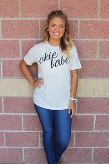 Okie babe unisex t-shirt.Let em know you're an Oklahoma babe in this easy to wear unisex tee! True to size unisex tee. 50% polyester 25% cotton 25% rayon. Exclusive to Lush by a local brand. Model is