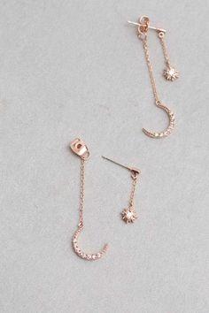 Crescent moon and star drop ear jacket earrings.
