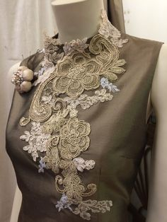 Lace collage on silk dress