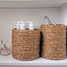 Wrap old coffee cans with rope for bathroom toiletry holder. Great idea!