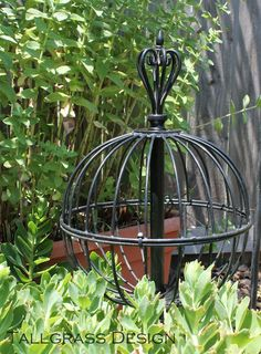 2 Hanging baskets + 1 ornamental curtain rod = Repurposed Garden Orb. Great idea!