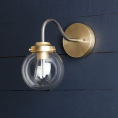 This Clear Glass Globe Wall Sconce fixture features Mixed Metals -Raw Brass Mount -Raw Steel Gooseneck pipe -Clear Glass Globe -110 / 220 Volt -60 Watts Max -UL Listed -Universal Mounting Bracket and