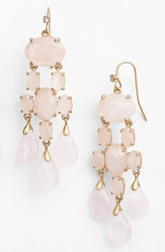 Romantic rose quartz stones trickle down a pair of lovely chandelier earrings perfect for spring and beyond.
