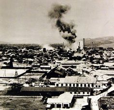 """Lot-11620-2: Allied Air Raids in Europe, WWII. Campina, Rumania, August 1, 1943. An oil tank at the Steaua Romana Refinery bursting into flames as a result of a direct hit by B-24 """"Liberator"""" bombers of the U.S. Army Air Force. U.S. Army Air Force Photograph. Office of War Information Collection. Courtesy of the Library of Congress."""