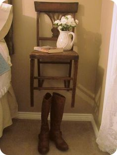 When I was little, my mom hung an antique chair on the wall and everyone thought it was weird.  I think it's wonderful.