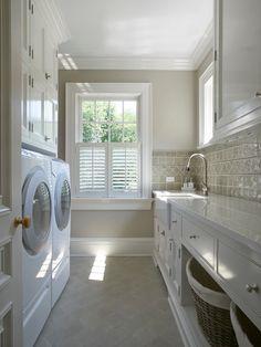 Traditional Laundry Room with Crown molding, Farmhouse sink, Hunter douglas newstyle hybrid shutters, limestone tile floors