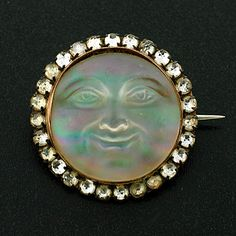 in honor of noel fielding: a beautiful victorian french paste and art glass man in the moon pin.
