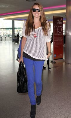 Nadine Coyle Beams In A Pair Of Colourpop Skinnies At The Airport 2012