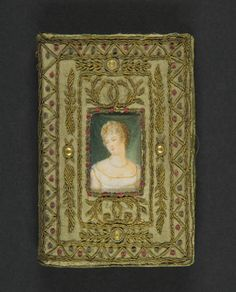 [Photographs of a binding of] The Metropolitan Museum of Art, New York. Thomas J. Watson Library (b16968669) #finebindings #rarebooks | The green silk is embroidered with gold thread medallions.