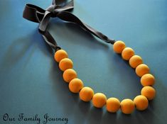 Wooden bead necklace - Great idea to paint the less-than-cute wooden beads I have.