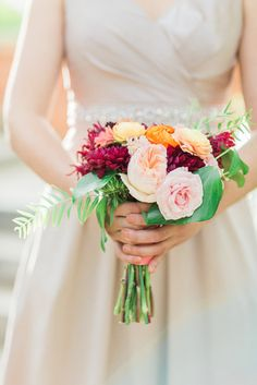 autumn wedding bridesmaid bouquet in blush, peach, orange and burgundy; fall wedding flowers by www.redpoppyfloral.com