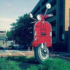 #BigVespa installed in downtown State College, PA.  go vespa art!  This 16' tall aluminum sculpture is a tribute to the vespa...a small and vulnerable scooter, yet owns its place in culture.