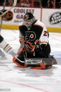 goalie-ron-hextall-of-the-philadelphia-flyers-makes-the-save-during-picture-id147492862 (410×612)