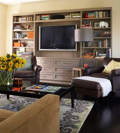 Media Built-In    For the best entertainment unit, consider shallow shelves, which are perfect for organizing books and media and keep with the proportions of slim, flat-screen TVs. If you have a deep wall, set the unit 4-6 inches into the wall to soften its impact on the rest of the room.