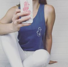 "Our anchor design is featured on the back of our washed indigo tank top! It's perfect to wear with your favorite cut offs or over your favorite swimwear!   Ultra-soft 100% Ringspun Cotton Unisex-fit Printed in the USA! Wash separately before wearing  *This shirt is made with a special pigment dye process in small craft batches. There will be subtle shade variations and color softening over time. This creates a ""lived in"" look which is a desired feature. Wash separately before wearing, then…"
