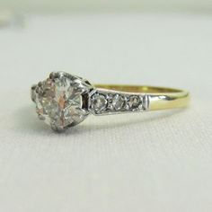 Diamond Engagement Ring, Circa 1930s. Old European Cut Diamond in Two Tone Gold Setting.. £1,050.00, via Etsy.