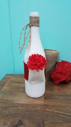 Check out this item in my Etsy shop https://www.etsy.com/listing/494279807/painted-wine-bottle-decorated-with-jute